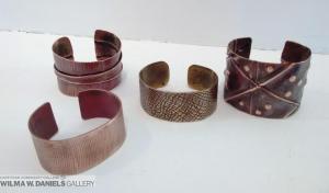 Cuff Bracelets by Larolyn Zylicz.