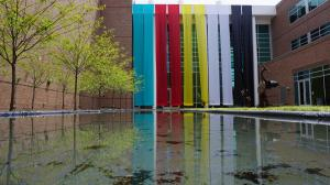 Banner Installation and Reflection Pond by Joan Farrenkopf