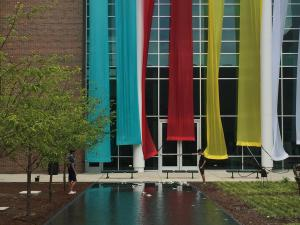 Banner Installation with Reflection Pond by Joan Farrenkopf